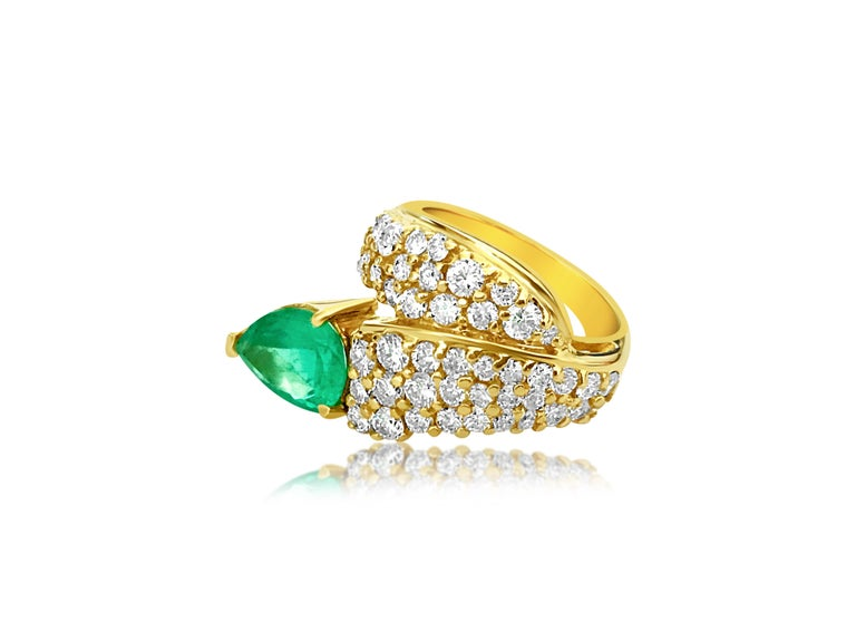 Metal: 14k yellow gold.   Emerald: 3.00 carats. 100% natural earth mined Colombian emerald. Pear shape emerald set in prongs. Strong color and saturation in the emerald.   Diamonds: 100% natural earth mined and genuine.  1.25 carat diamonds total.