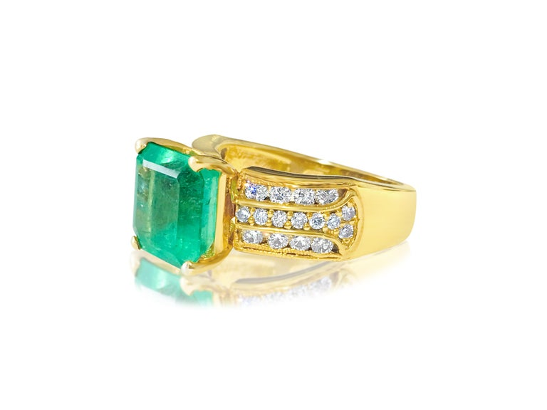 Metal: 14K yellow gold.   6.00 carat Colombian emerald. Cut: Emerald. 100% natural earth mined gemstone. Gorgeous hue and intense green color.   1.00 carat diamonds total, round brilliant cut. VS-SI clarity and G color. 100% natural earth mined