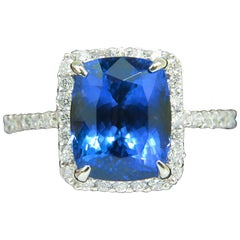 Natural 6.23 Carat Tanzanite Halo Diamond Ring A+ Cushion Cut and Luster VS