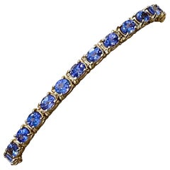 Natural 9 Carat Oval Tanzanite Tennis Bracelet 14 Karat Yellow Gold