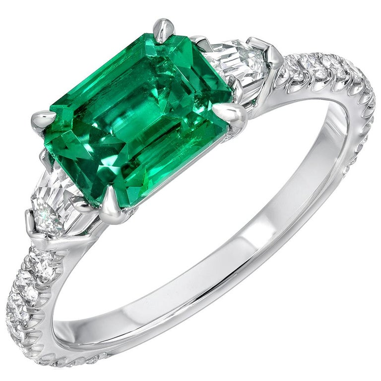 Exceptional platinum ring featuring a collection-quality 1.47 carat, no oil, emerald-cut Emerald, from Panjshir Afghanistan. This Emerald is flanked by a pair of 0.27 carat total, French-Cut bullet shaped diamonds, E color and VS1 clarity, and
