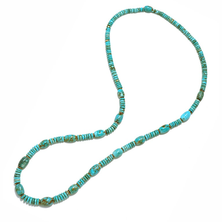 Each bead of turquoise from the Number 8 turquoise mine in Nevada is hand carved from natural rough stone, shaped & polished by the artist and strung with 18k gold spacer discs to craft this 24
