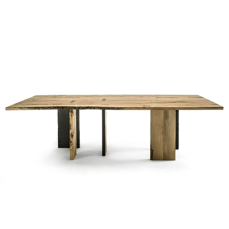 Dining table natural and burnt oak raw with all structure in natural solid oak raw wood and with natural burnt solid oak raw wood. With 5 strong feet with one side in burnt oak wood and one side in natural oak wood. Treated with wax with