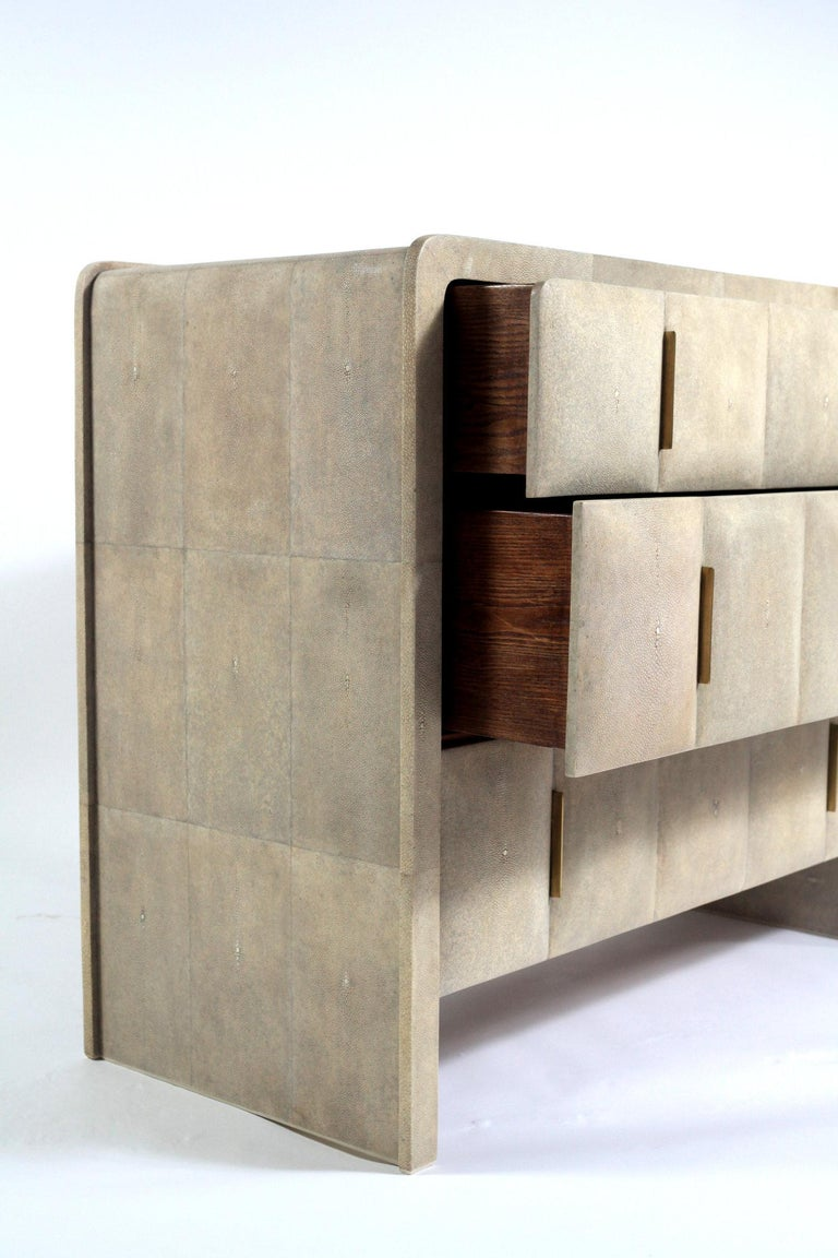 Natural shagreen  Antique stain brass pulls  Three drawers  Dimensions: 42.5