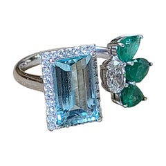 Natural Aquamarine, Emerald and Diamond Ring Set in 18 Karat Gold