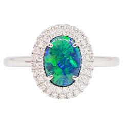 Natural Australian AAA Intensity Black Opal and Diamond Halo Ring 14 Karat Gold