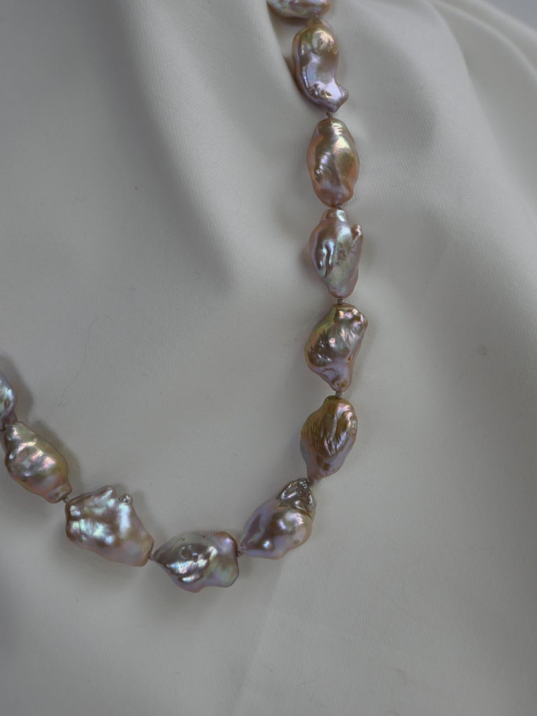 This natural color baroque cultured pearl necklace is absolutely beautiful. This is a statement necklace. The baroque cultured pearls are natural tones with golden, white, beige tonality. The pearls have great luster.  The necklace is individually