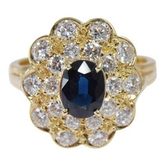 Natural Blue Sapphire in a Double Diamond Halo Set in 18Kt Yellow Gold Ring