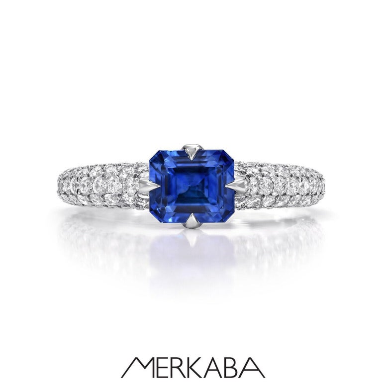Superb natural, unheated 1.42 carat Blue Sapphire emerald cut, unveiled in a 1.32 carat diamond micro set pave platinum ring. AGL certificate is attached to the image scroll for your convenience. This gem displays pure and rare beauty and is out of