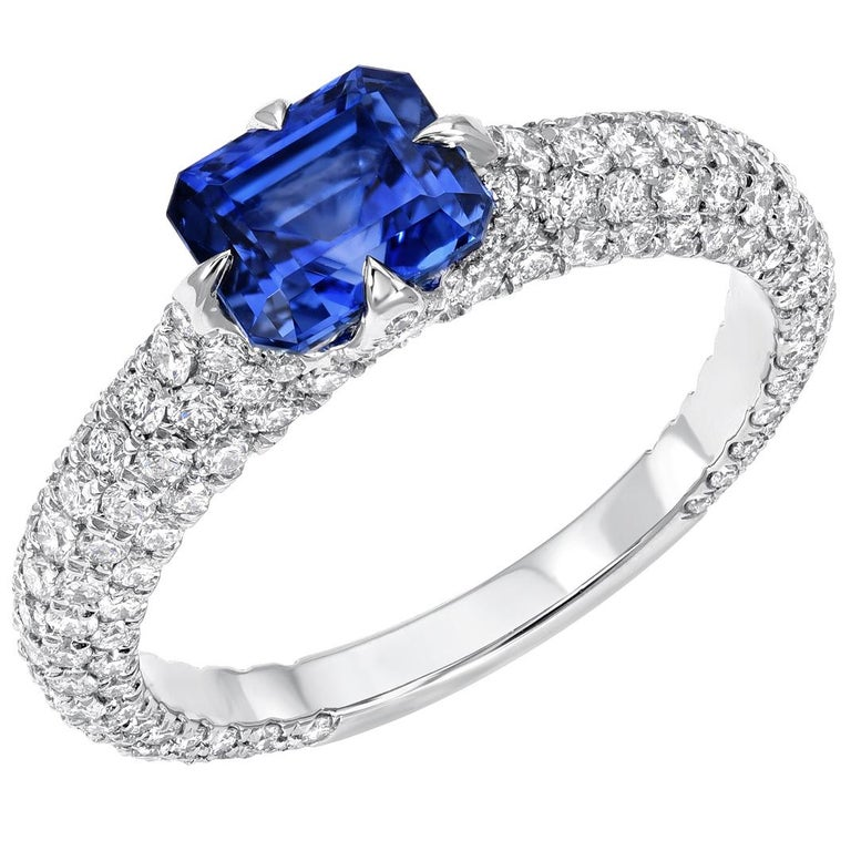 Unheated Sapphire ring showcasing a 1.42 carat emerald cut Blue Sapphire, unveiled in a 1.32 carat micro pave diamond platinum setting.  The AGL certificate is attached to the images for your convenience.  Ring size 6. Resizing is complementary upon