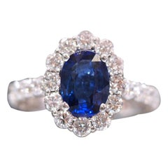 Natural Blue Sapphire Set in a Custom Made Nature Inspired Flower Halo Ring
