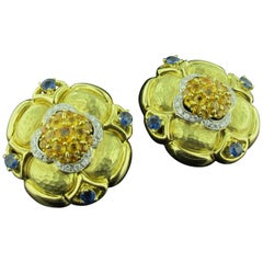 Natural Blue and Yellow Sapphire Earrings Set in 18 Karat Hammered Yellow Gold