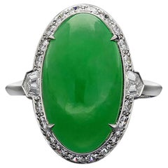 Natural Cabochon Oval Jade, A Grade & Diamond Platinum Cluster Ring by Hancocks