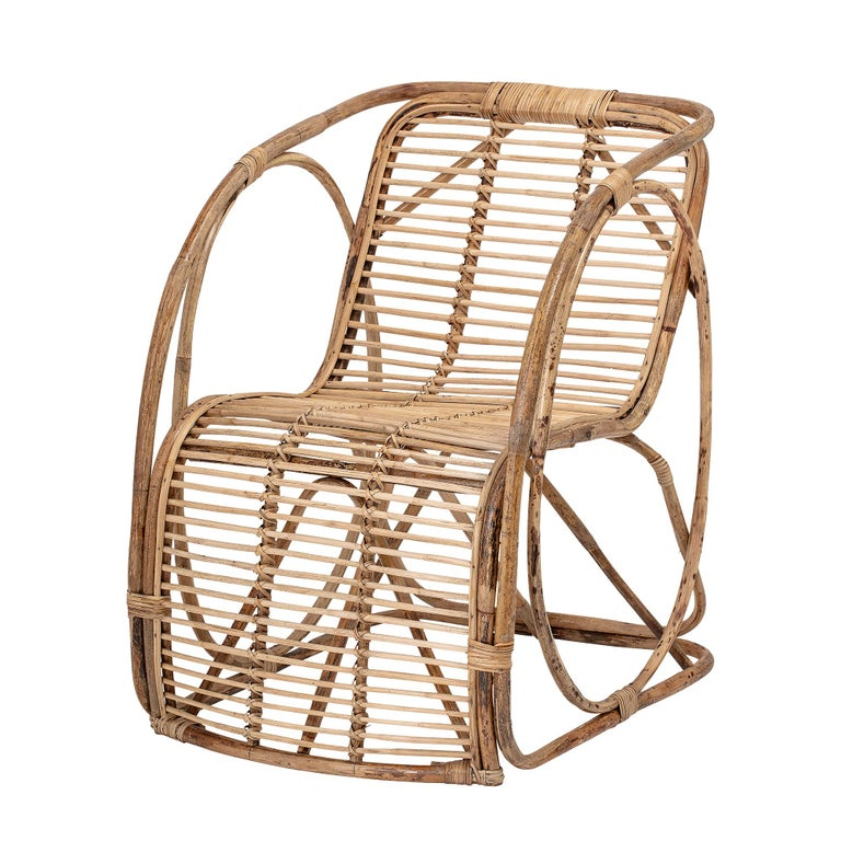 Un-dyed natural full cane lounge chair. Tones of the unvarnished cane may vary.