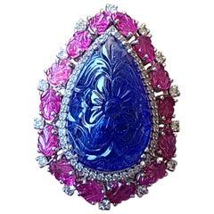 Natural Carved Tanzanite, Ruby and Diamond Ring Set in 18 Karat Gold