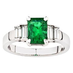Natural Colombian Emerald and Baguette Diamond ring in 18 Carat White Gold