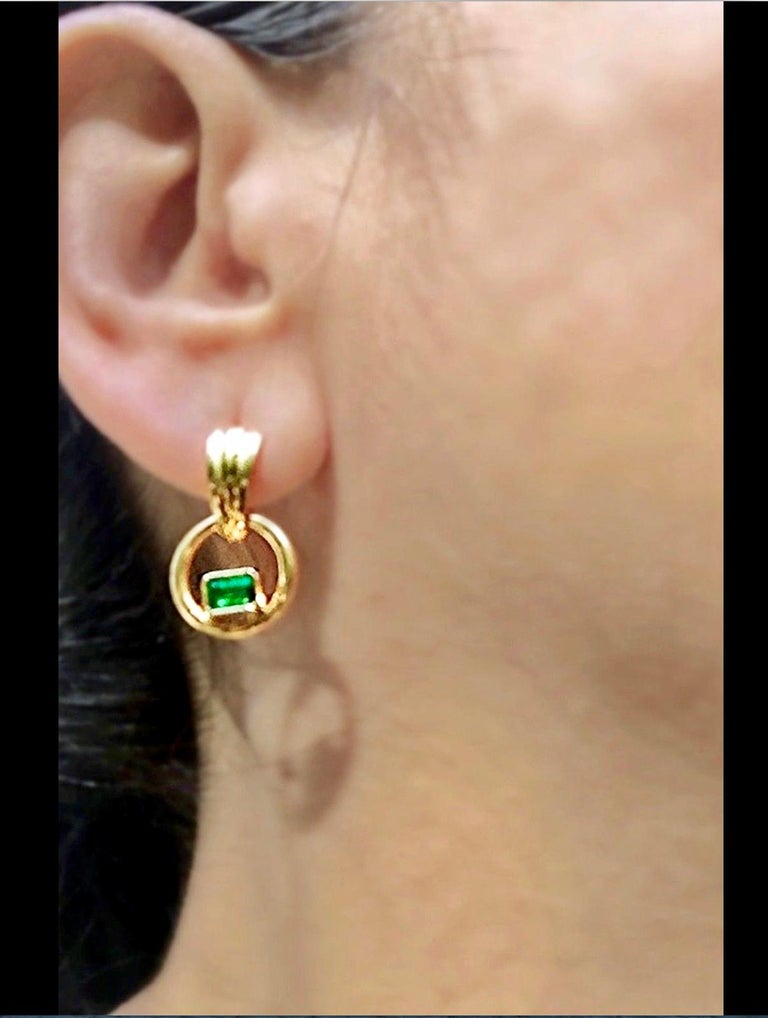 Classic Clip-on Dangle Earrings Natural Colombian Emerald Total length Earrings: 22.0mm Shape or Cut : Emerald Cut Average Color/Clarity : AAA+ Medium Green/ Clarity VS  Emerald Weight : Over 0.50 carats Emerald measurements: 4.5x3.5mm Total length