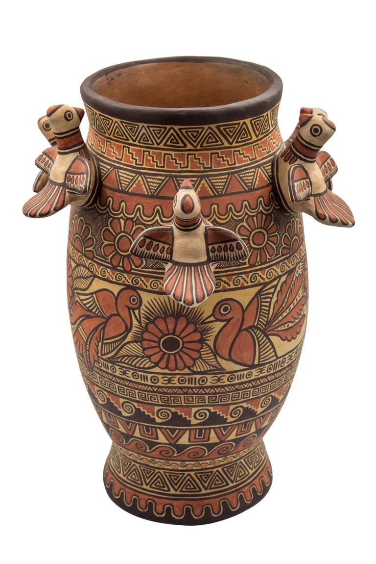 Beautiful natural clay vessel made in Izucar de Matamoros, in the state of Puebla México. Hand painted using natural dyes by master artisan Marco Antonio Castillo, son of renowned artists, Alfonso Castillo. This rustic Mexican ceramic vase portraits