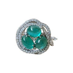 Natural Emerald Cabochon Ring Set in 18 Karat Gold with Diamonds