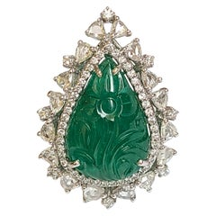 Natural Emerald Carving Ring Set in 18 Karat Gold with Diamonds