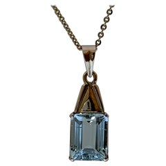 Natural Emerald Cut Aquamarine Pendant Set in 14 Karat Gold