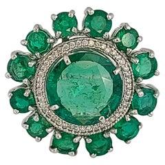 Natural Emerald Ring Set in 18 Karat Gold with Diamonds