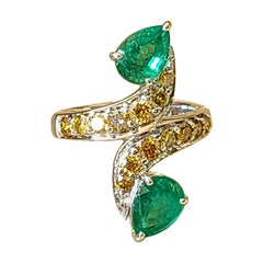 Natural Emerald Ring with Yellow Diamond Set in 18 Karat Gold