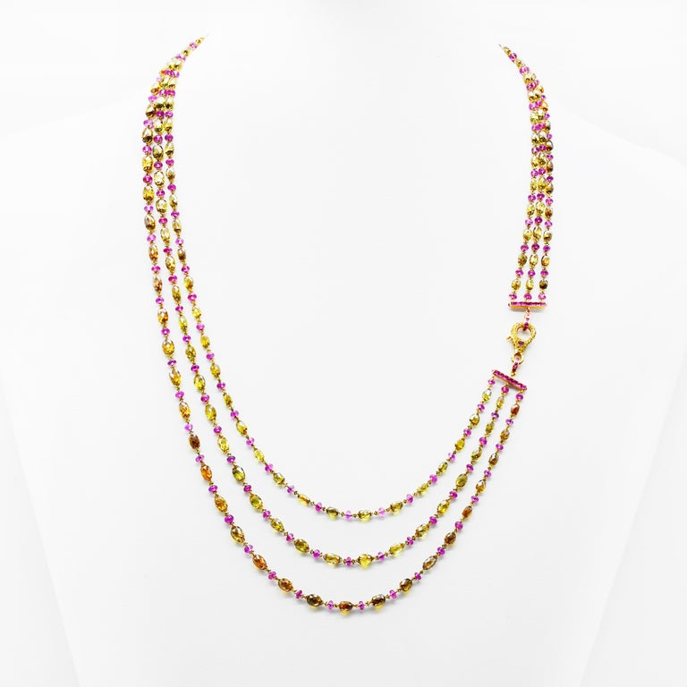 This Three Line Necklace Features 18 Karat Yellow Gold With A Combination Of  Non-Heated Burmish Ruby And Mix Fancy Color Diamond Briolette with Studded Lock. It Has Total 45.37 Carats In House Polished Natural Fancy Color Diamond Briolettes and