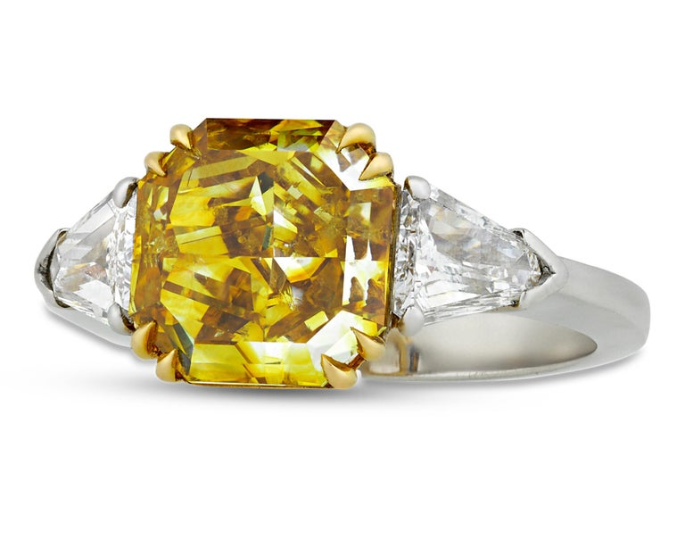 A rare 4.01-carat fancy deep yellow diamond displays a remarkable depth of color and brilliance in this extraordinary ring. Prized for both their beauty and rarity, yellow diamonds of this quality are among the most desirable and radiant of colored
