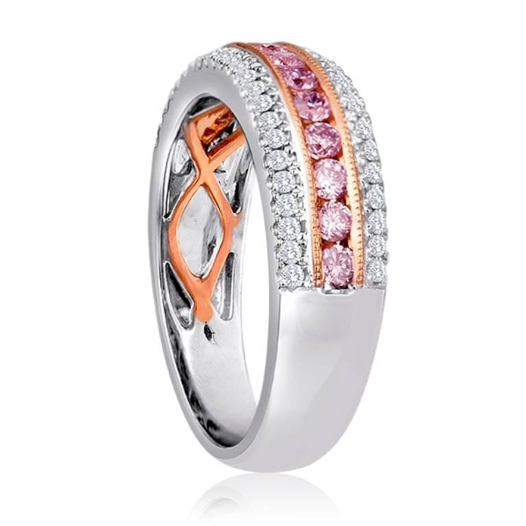 Gorgeous Natural Pink Diamonds 0.47 Carat Flanked By Two Rows of White Diamond Round on the Sides 0.28 Carat  in 18K White and Rose Gold Band Ring.  Total Diamond Weight 0.75 Carat  Style available in different price ranges, can be customized or