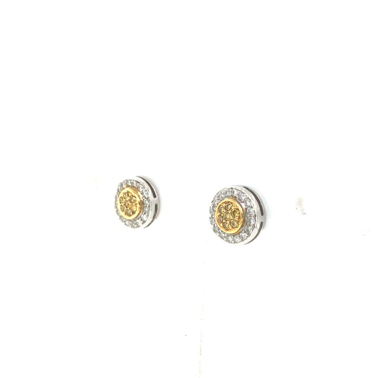HJN Inc. Ring featuring Natural Fancy Yellow Diamond Cluster Earrings  Natural Fancy Yellow Diamonds: 0.10 Carats Round-Cut Diamond Weight: 0.17 Carats  Clarity Grade: SI1 Color Grade: G-H Total Diamond Weight: 0.27 Polish and Symmetry: Very