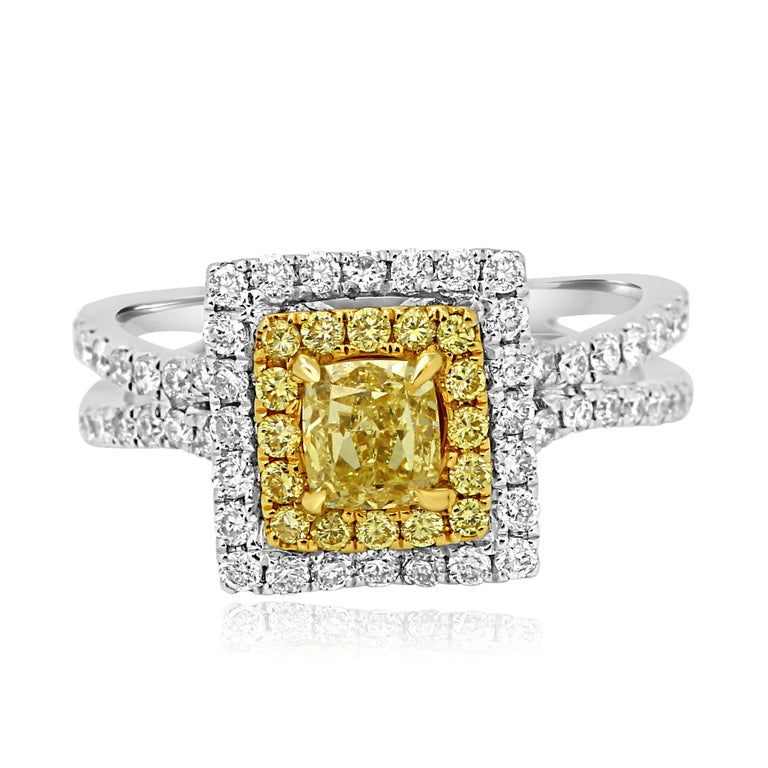 Natural Fancy Yellow Cushion 0.64 Carat in double Halo of natural fancy yellow round 0.19 Carat and white diamond round 1.00 Carat. In split prong 18K White and Yellow Gold ring.  Style available in different price ranges. Prices are based on your