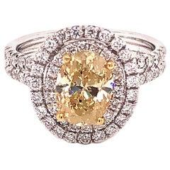 Natural Fancy Yellow Oval Diamond Halo Ring, 1.60 Carat, 18 Karat 2.34 Carat