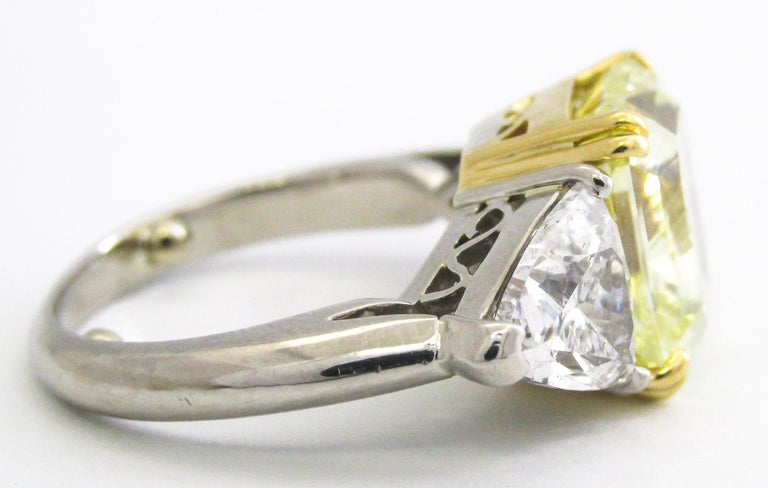 This stunning 6.15 carat natural fancy yellow radiant cut diamond exhibits an exceptionally strong lemon yellow color along with an amazing saturation, brilliance and fire. Exceptionally well cut, without having excess weight in the lower portion of