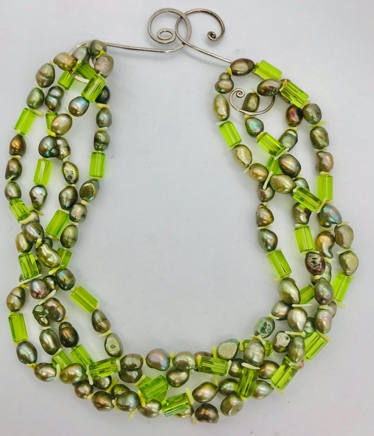 Green Pearls and green natural faceted 10 mm Peridot beads with silver clasps. White branch coral  spacer. 68