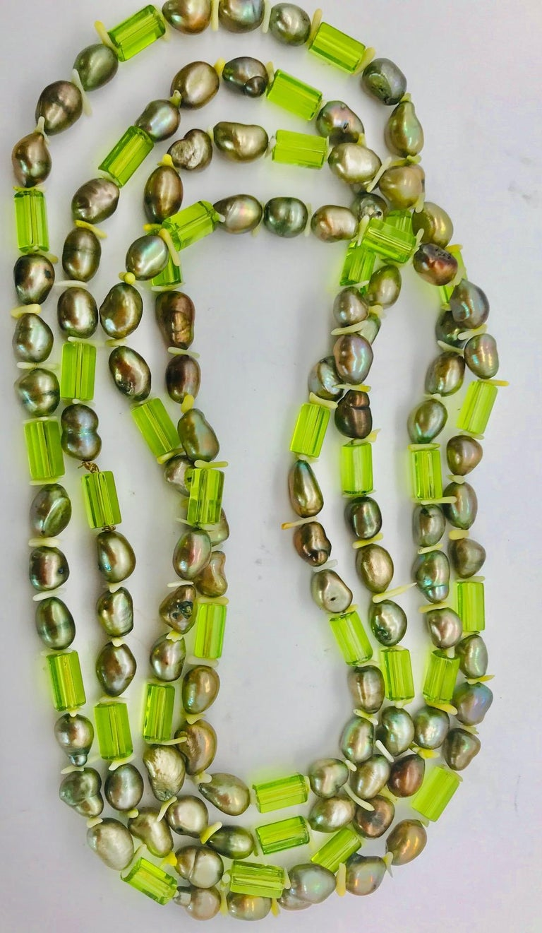 Contemporary Natural green Pearls and  Peridot Stones with Silver clasp, by Sylvia Gottwald For Sale