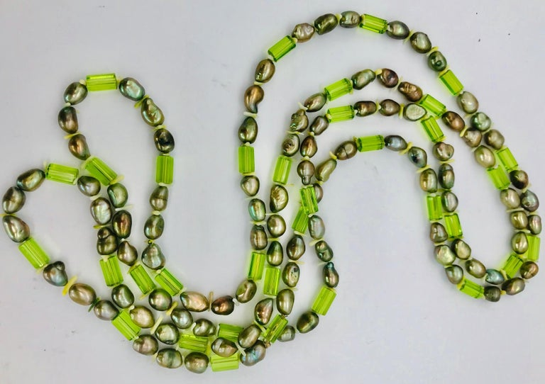 Bead Natural green Pearls and  Peridot Stones with Silver clasp, by Sylvia Gottwald For Sale