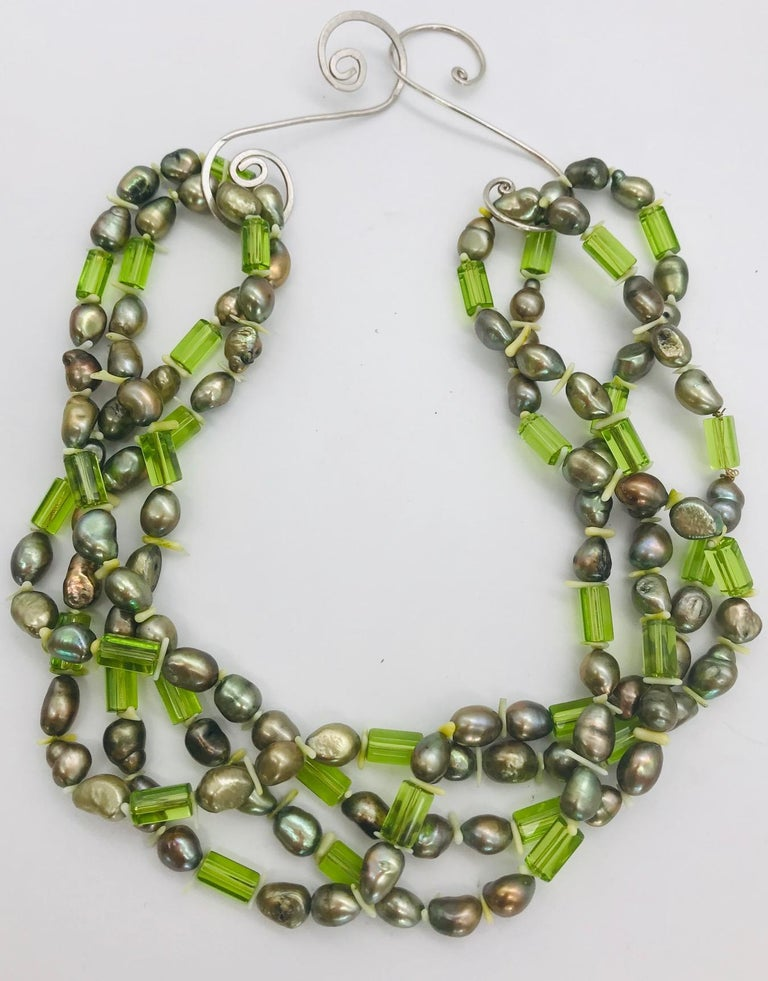 Women's Natural green Pearls and  Peridot Stones with Silver clasp, by Sylvia Gottwald For Sale