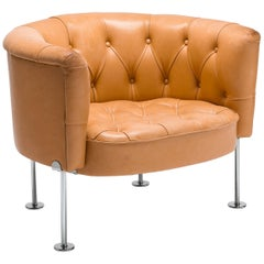 Natural Leather Tufted Leather Club Chair by Robert & Trix Haussmann