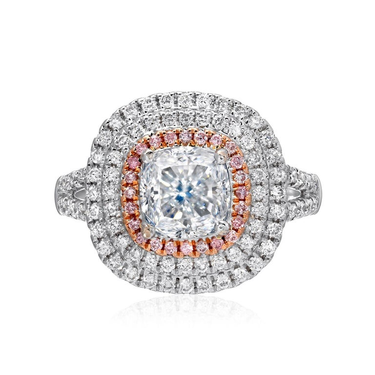 Spectacular G.I.A certified 2.01 carat, natural light blue diamond cushion cut, SI1 clarity, set in a 18K white and rose gold cocktail or diamond engagement ring, adorned by a total of 0.10 carat pink diamonds and 0.56 carats of round brilliant