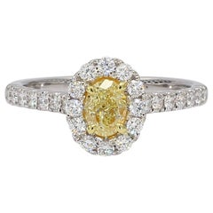 Natural Light Yellow Oval Diamond Engagement 18K Ring 0.97 Cts TW