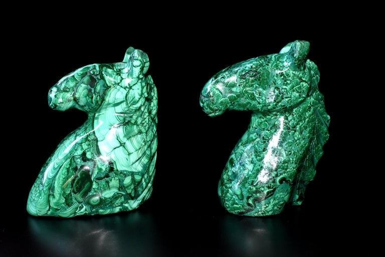 A pair of beautiful horse sculptures in the most spectacular natural malachite. All natural with splendid swirls and patterns, these remarkable pieces make wonderful bookends and paperweights. Malachite is a stone of transformation, helping one