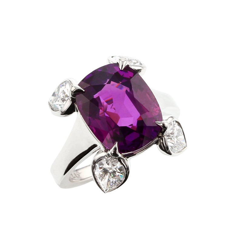 A beautiful and natural, no heat purple sapphire weighing 8.61 carats set with four pear-shape diamonds, set in Platinum. The sapphire accompanies a gemological certificate from GIA stating the origin as Ceylon (Sri Lanka) with No Indications of