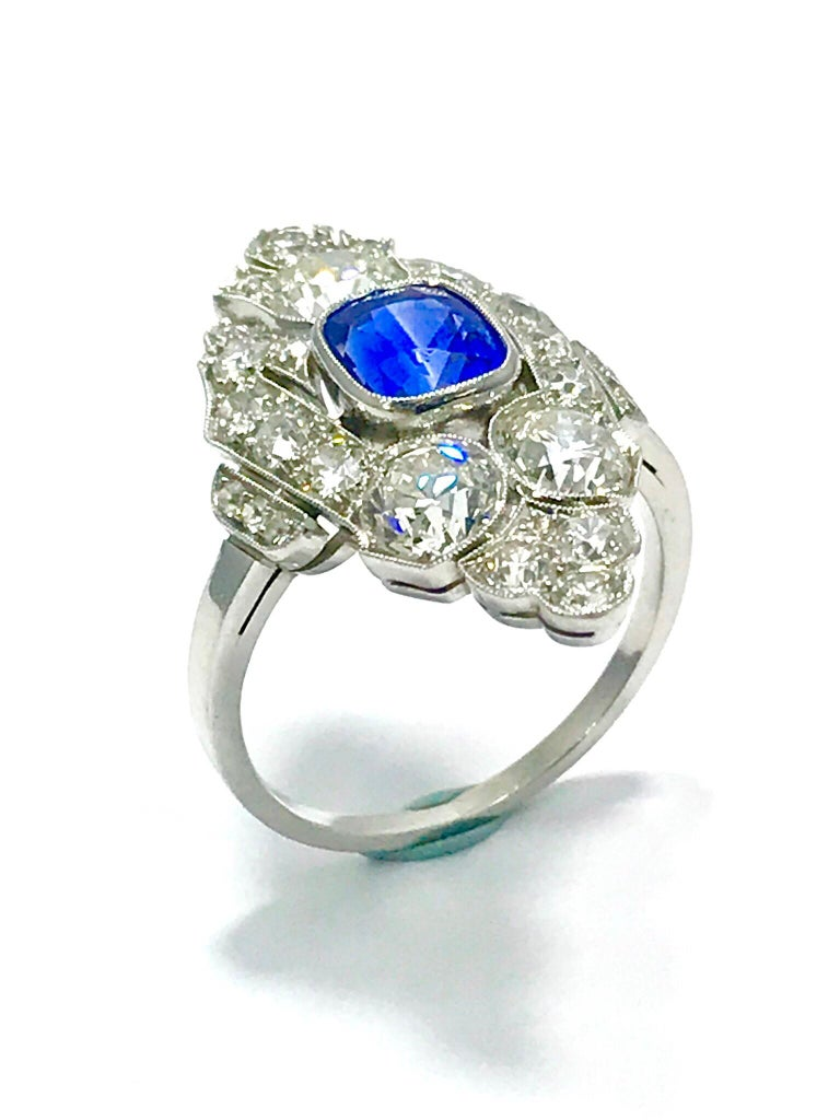 This is a stunning Art Deco natural no heat Sapphire and Diamond platinum ring.  The sapphire is cushion in shape, and bezel set with a milgrain edge.  It measures 6.90 x 5.80 x 4.90 millimeters, and weighs approximately 1.72 carats.  The sapphire