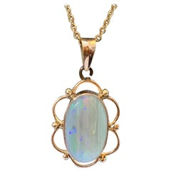 Natural opal pendant set in 14 Karat Yellow Gold