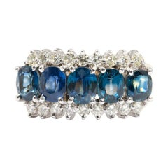 Natural Oval Sapphire and 0.54 Carat Diamond 18 Carat Gold Vintage Cluster Ring