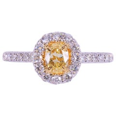 Natural Oval Yellow and White Diamond 0.94 Carat Total Diamond 18K Gold Ring