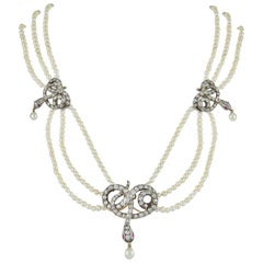 Natural Pearl Necklace with Diamond Set Snakes
