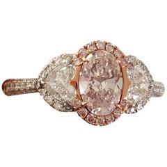 Natural Pink Diamond Oval with White Diamonds in 18 Karat White Gold