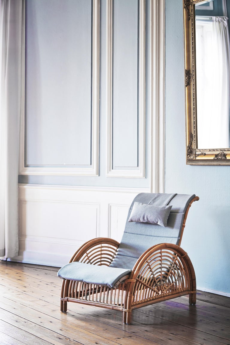 Arne Jacobsen designed the original Paris chair in 1925. This sculptural rattan piece was Jacobsen's first furniture design and won a silver medal at the Paris Art Deco Fair. This chair's striking curvature makes for an elegant and comfortable work